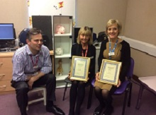 CEO Daniel presenting Award of Excellence to Audiology staff