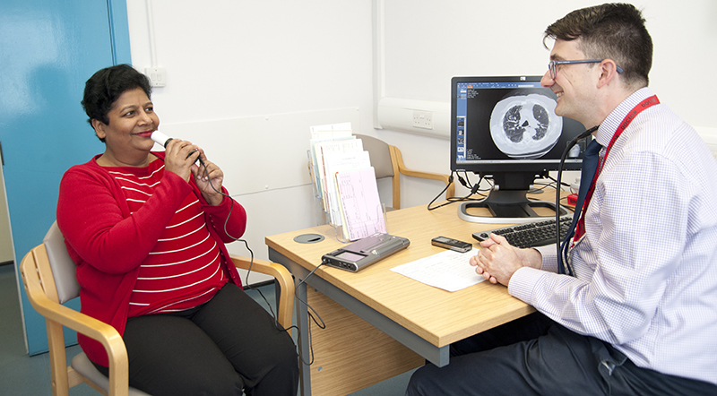 Dr Thomas Medveczky and a patient performing a spirometry breathing test