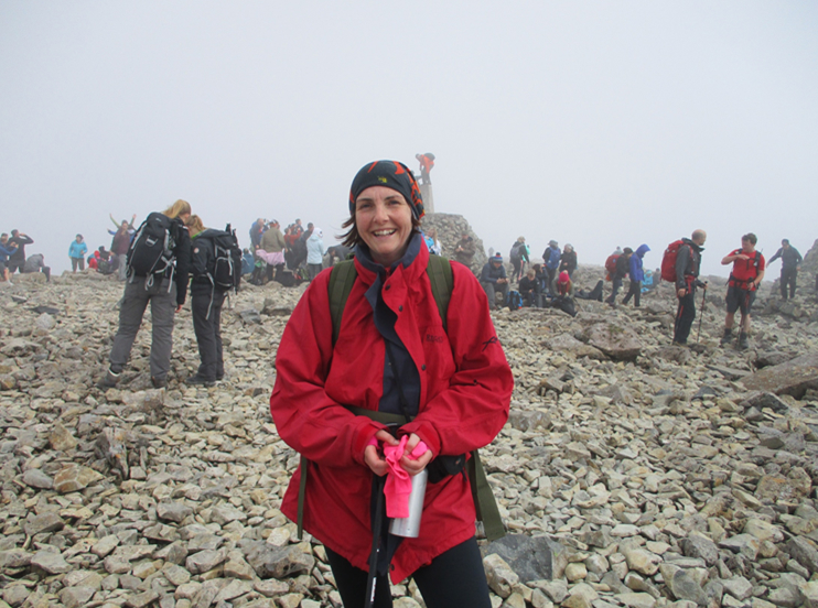 Laura Rowe compliance manager and midwife at teh summit of Ben Nevis
