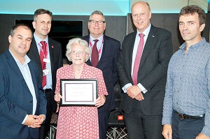 Rosemary Brakell receiving her award for 40 years as a volunteer, presenting by CEO Daniel, Chairman Laurence, and MPs Paul Scully, Chris Grayling and Tom Brake.