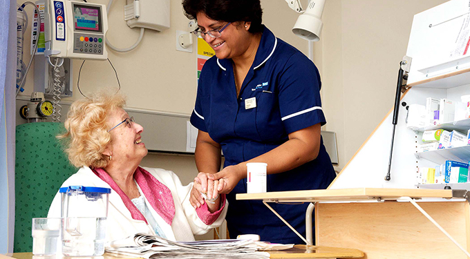 A ward sister provides reassurance to a patient