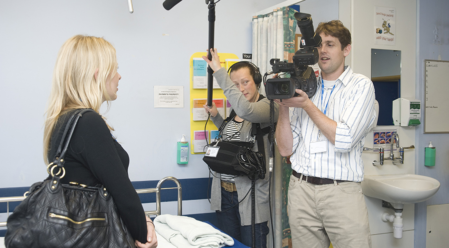 A film crew interviewing a junior doctor